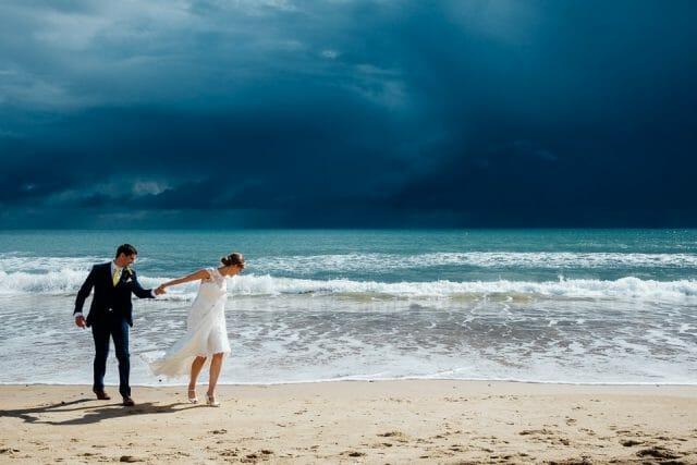 epic sky wedding couple beach