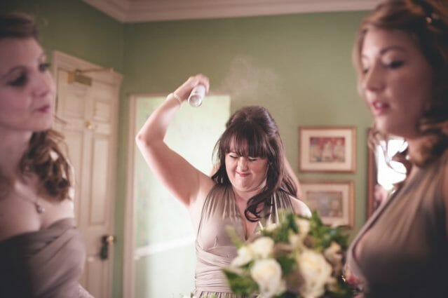 bridesmaid spraying hair London Alternative Candid Relaxed Fun Alternative Documentary Wedding Photography